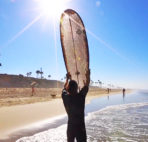 An eco-friendly surfboard made from durable cardboard designed by Ernest Packaging Solutions and Signal Snowboards